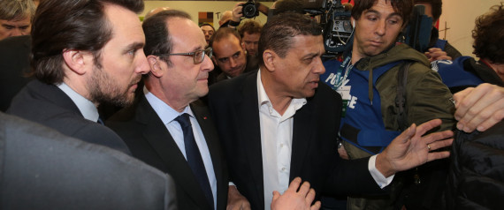 "French President Francois Hollande (C) and President of France's National Federation of Agricultural Holders' Unions (FNSEA) Xavier Beulin (R) attend the opening of the ""Salon de l'Agriculture"" (Agriculture Fair) in Paris on February 26, 2016. President Francois Hollande was heckled today as France's annual agricultural fair kicked off against the backdrop of the ""worst crisis ever"" facing the country's farmers. AFP PHOTO / JOEL SAGET / AFP / JOEL SAGET"